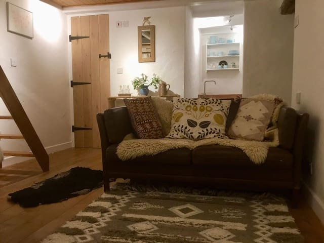 The cosy sitting room. Bathroom door to the left, kitchenette to the right.
