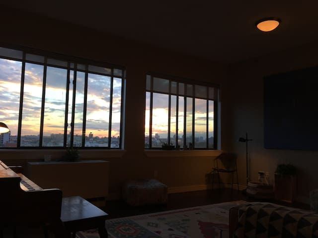 Sunny room in Bushwick loft with private balcony