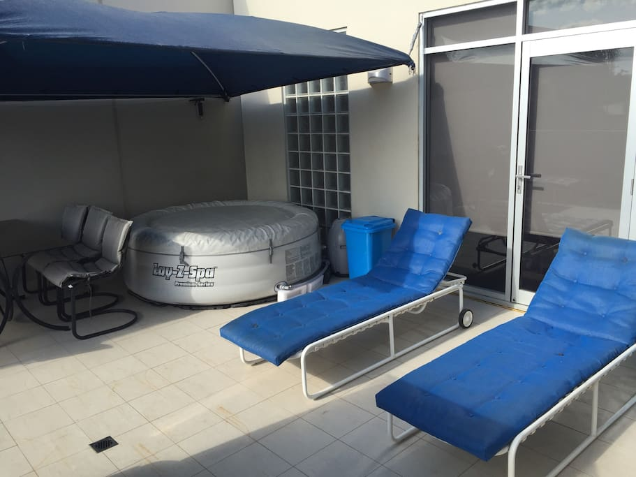 Outdoor spa, dining & resort lounges