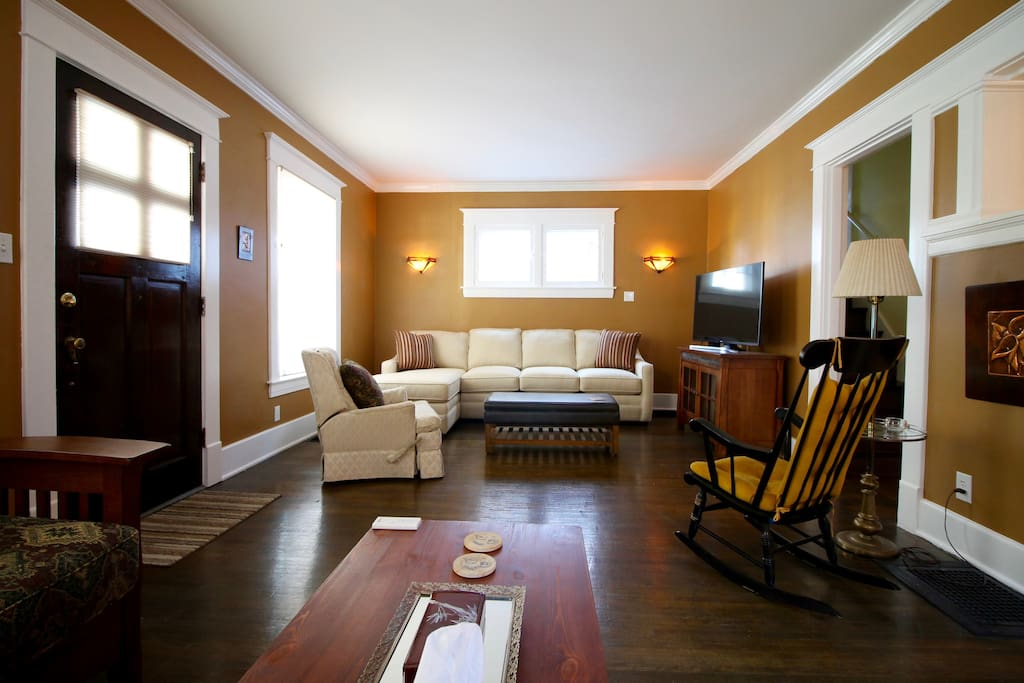 """View of the other half of the living room. The """"L"""" shaped sofa is brand new and VERY comfortable. The cushions can be removed to reveal a comfortable queen bed."""