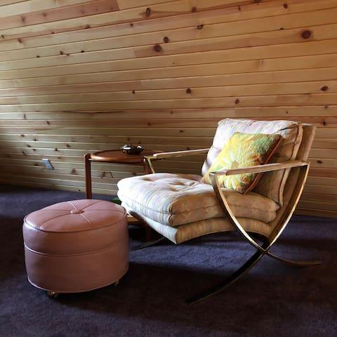Brass lounge chair in loft.  c1970's