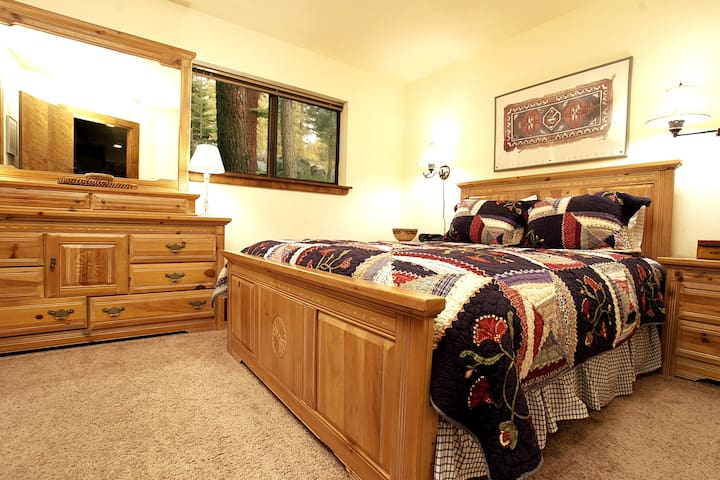 One of the two Queen Bedrooms on the entry level. (We have a set of twin bunk beds in the small utility area, too.)
