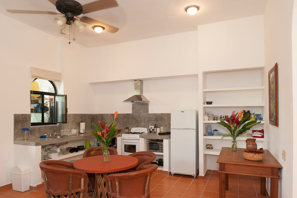 A fully equipped kitchen complete with full size fridge, stove and oven and a pantry