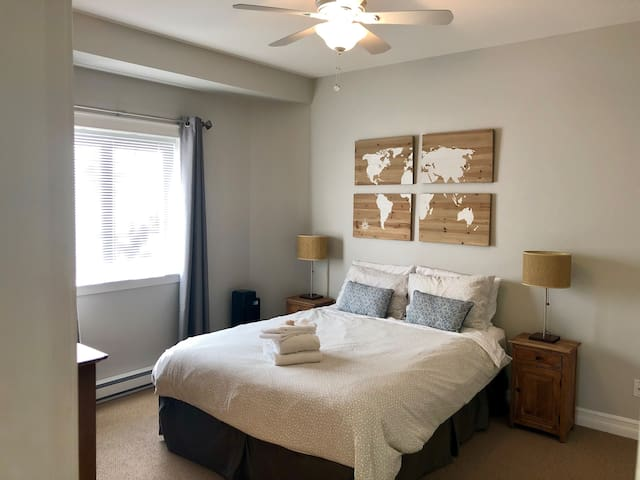 Master bedroom with lots of space, ceiling fan and carpeted floor