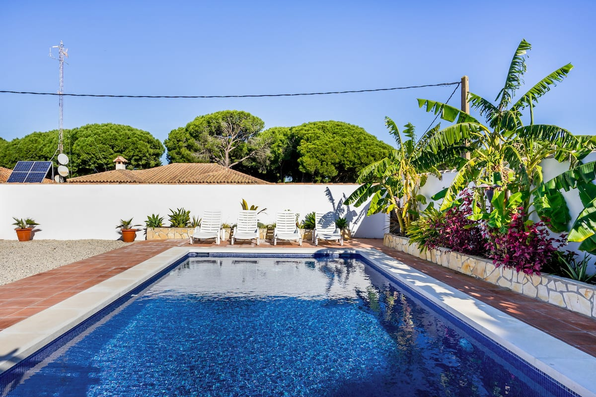 Walk to the Beach from a Charming Home with a Hot Tub