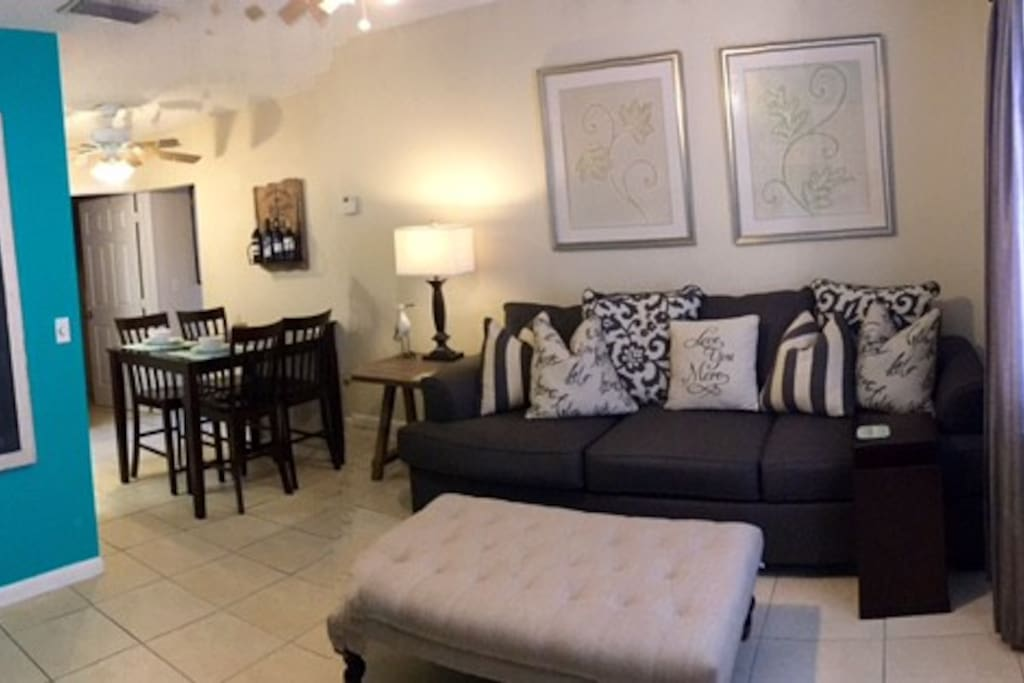 This is our beautiful living room. The couch is brand new with a memory foam queen mattress.
