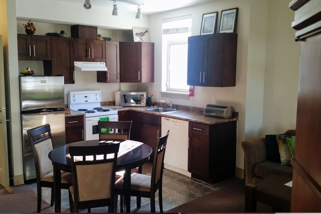 Kitchen in Main Rm 2Rm Studio with Balcony  2 Queen beds & Sofa bed Sleeps 3 singles or 3 couples, Pemberton Gateway Village Suites Hotel