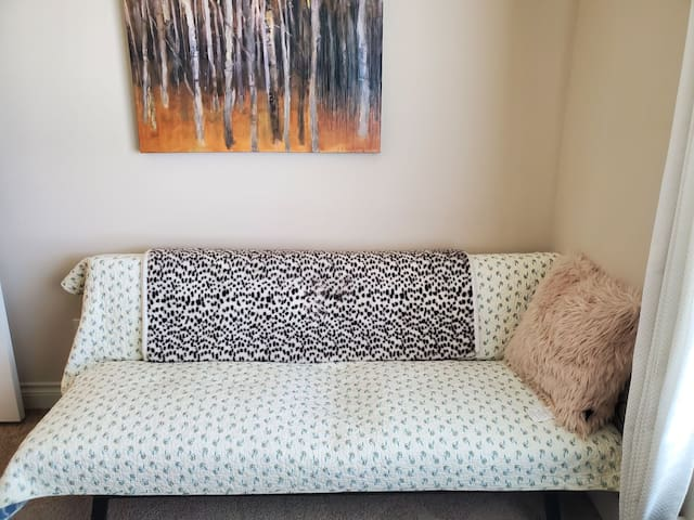 In the fourth bedroom, the sofa can be opened to sleep