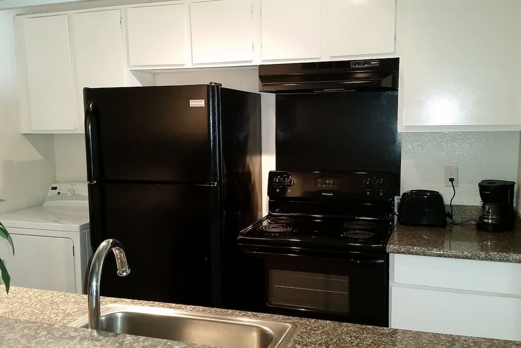 Kitchenette. Coffee maker, toaster, microwave, fridge, electrical stove/oven and dishwasher.