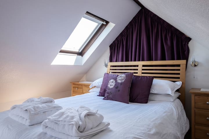 Double bedroom set in the eves of the barn