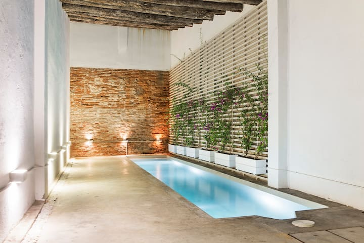 Stunning Loft Apartment with Private Garden & Pool