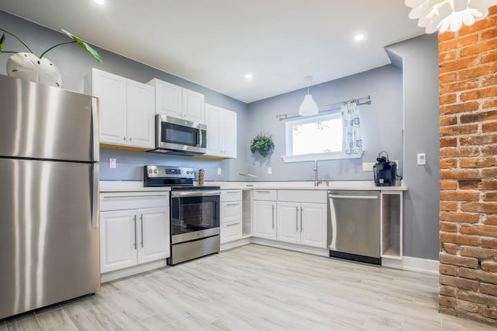 Brand new kitchen with everything you need to feel at home.  Keurig with pods, fridge with icemaker, pots, pans and utensils are ready for  your stay.