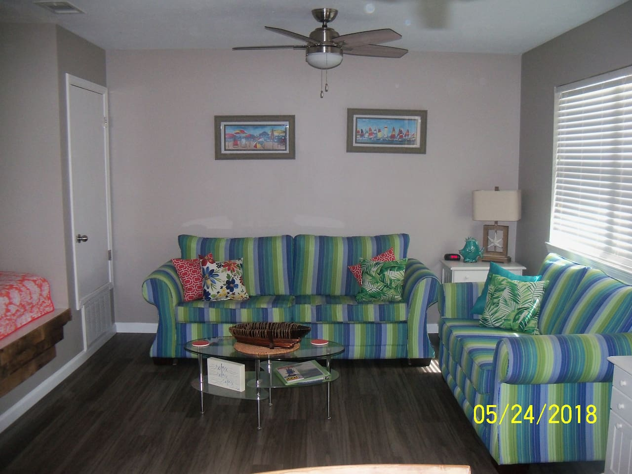Living room area with queen sleeper sofa, wall mounted television, WIFI