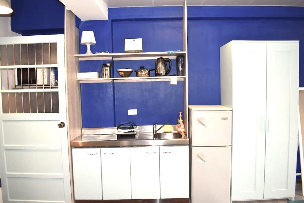 Kitchen: has microwave, electrical stove (1 plate), hot water kettle, fridge (with freezer department). We also provide iron, hair dryer and washing machine as well as detergents.