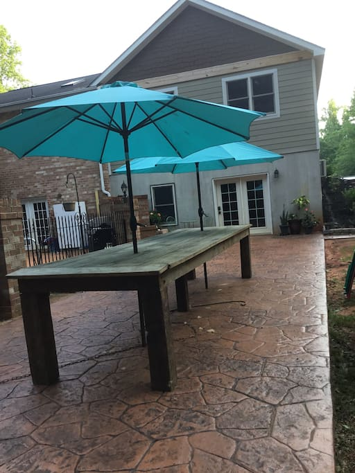 Patio with large barn wood table for gatherings outside