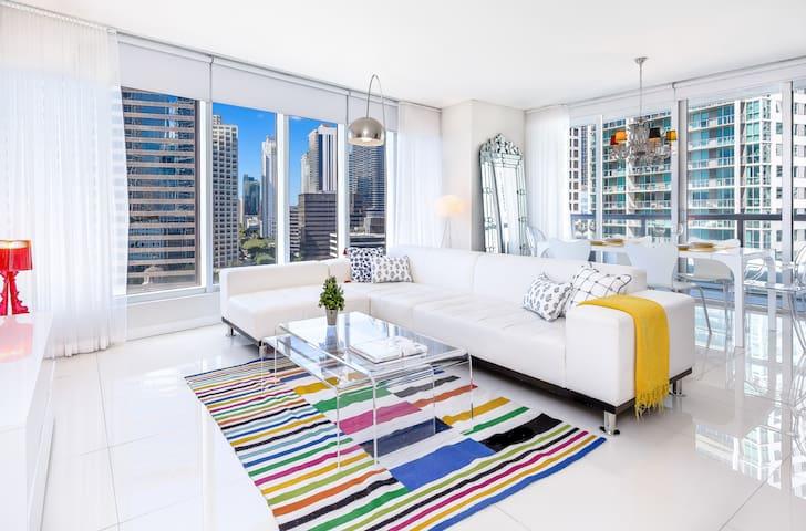 Large living area with plenty of light, ocean views, modern design.