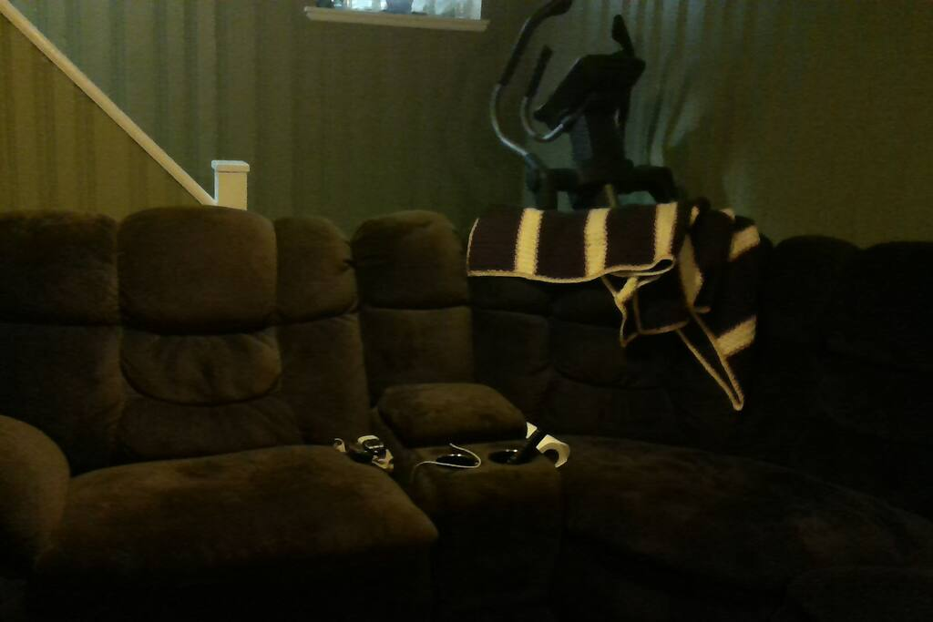 Family room has large sectional for watching movies on the big screen