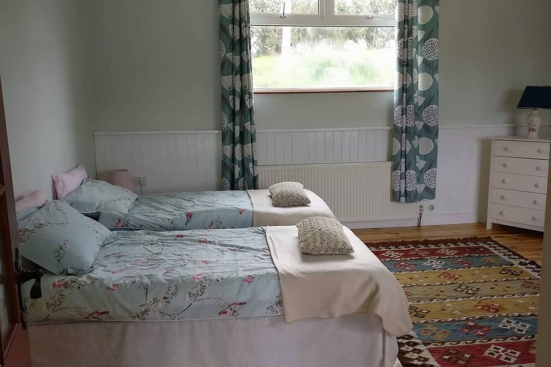 Bedroom 1, 3 single beds