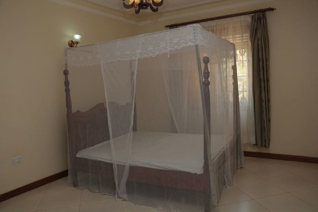 Mosquito net covers the bed fully for your protection and peaceful night