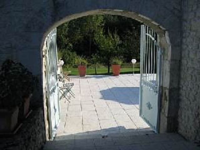 Gateway between courtyard and terrace