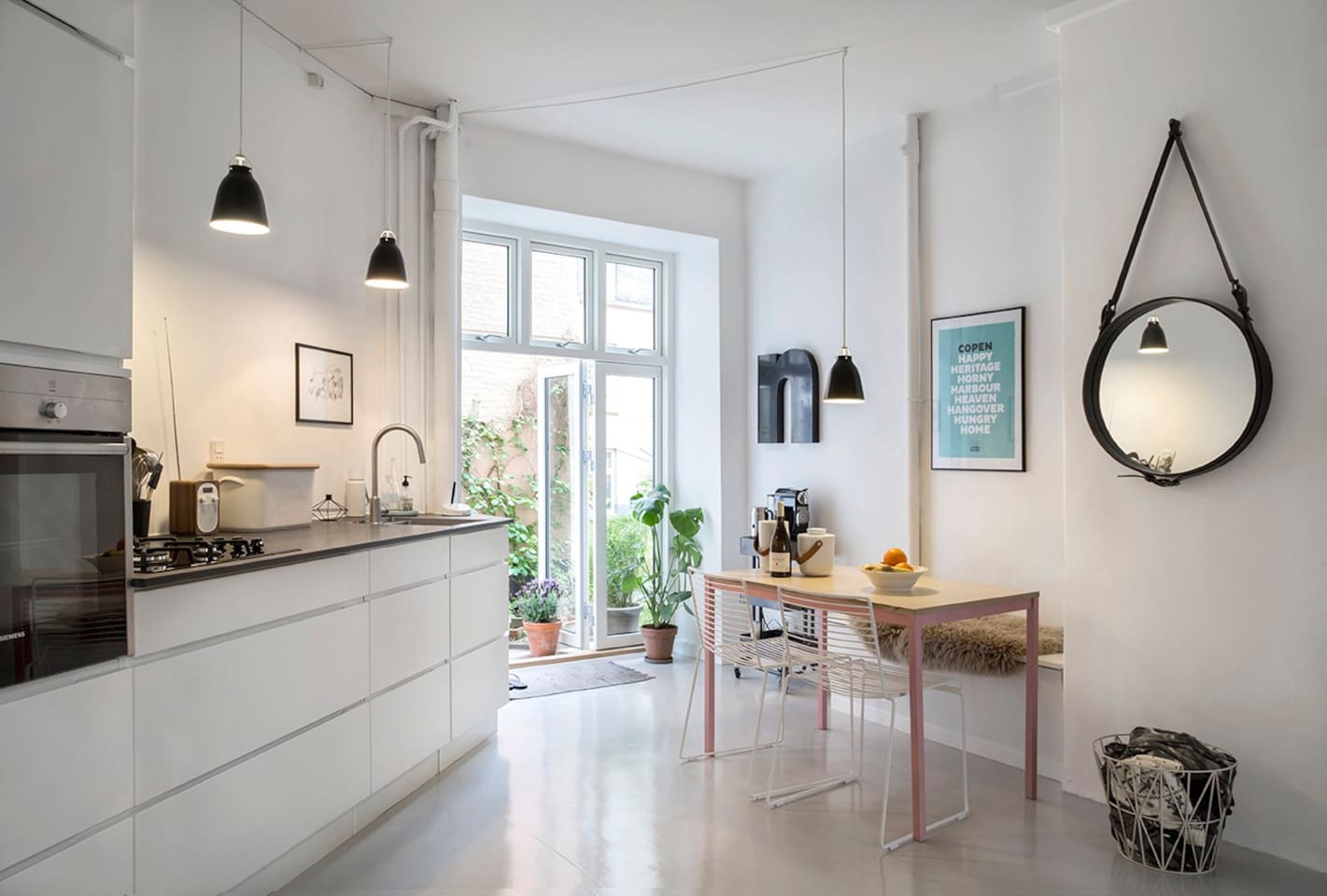 Nice kitchen with directly access to green courtyard.