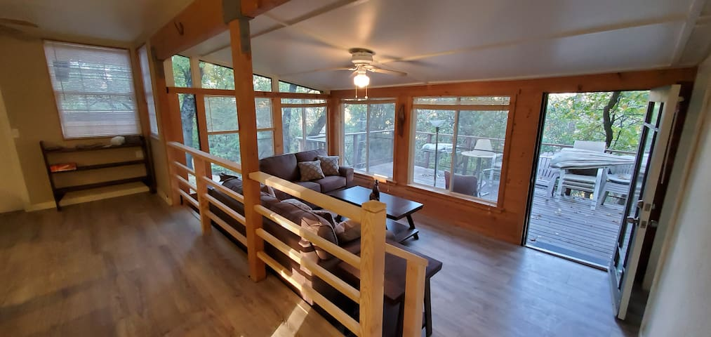 Living room and deck with mountain views