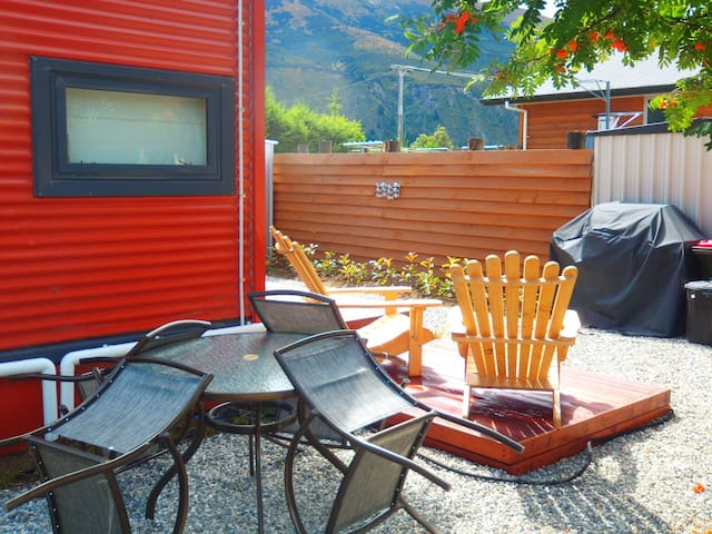 Studio Room with seating outside with a BBQ in a sunny spot