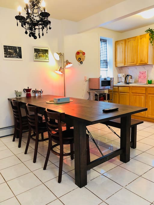 Large natural oak wood dinning table; easy to seat 7 guests comfortably. Smart standing lights controlled by voice; want different color combinations? Just download the Philip Hue smart light app and play around