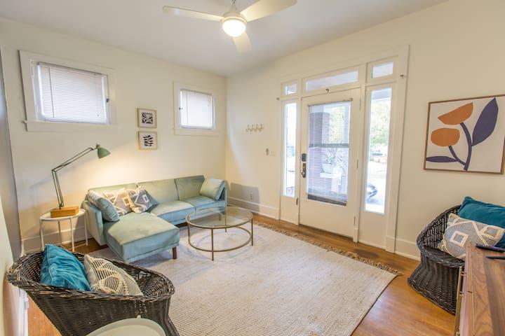 Living space with velvet sofa.