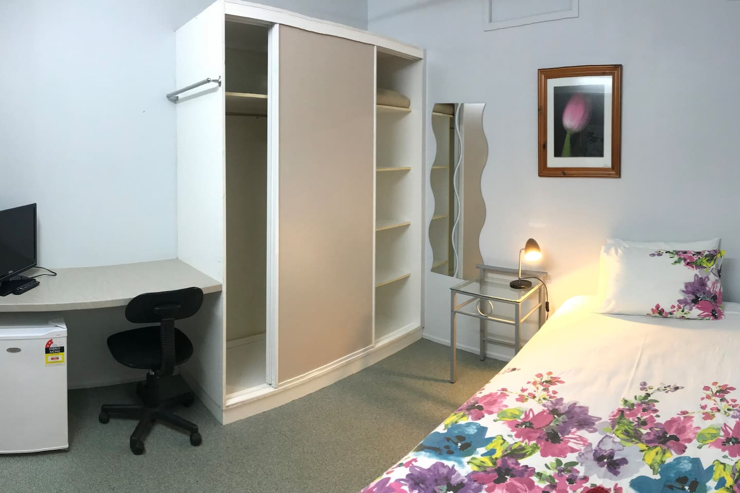 Single room with Shared Facilities.  Comfy King Single Bed, Wardrobe and bar fridge.