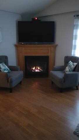 A cozy propane fireplace keeps the guest suite warm all winter