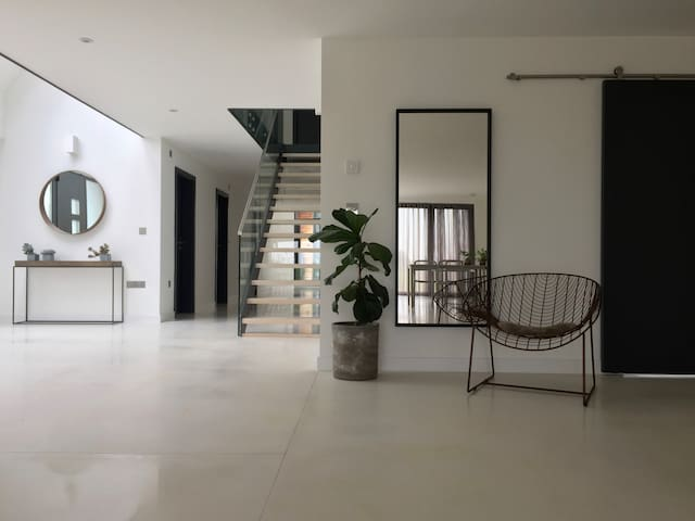 entrance hall with white polished concrete floors.
