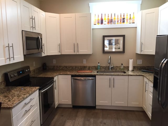 Full Kitchen with Stainless appliances and granite countertops