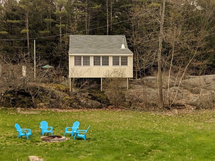 Escape to a cozy lakeside cottage