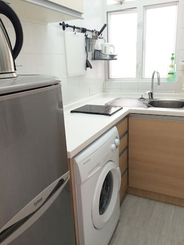 Kitchen equipped with refrigerator and freezer, washing machine, enduction cooker, kettle and all equipment to prepare your own meal or simply make a morning coffee.