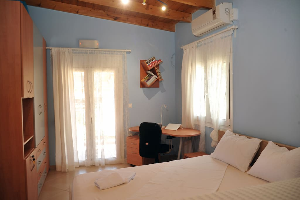 Bedroom 20 m2,  include: A double bed + one single bed + wardrobe + Baby Playpen + Air conditioning