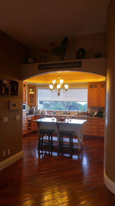 Chef's kitchen with island overlooking Atlantic