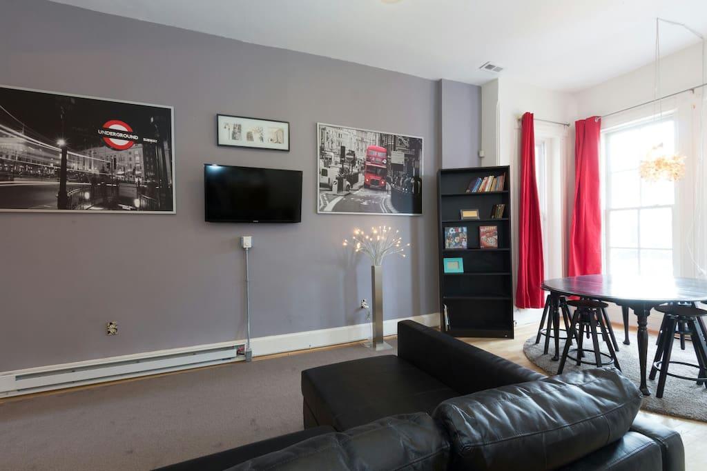 "Living room. 40"" mounted Smart TV with sleeper sofa."
