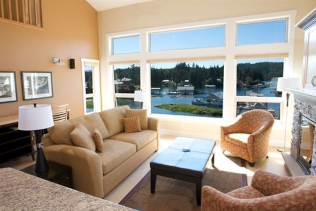 Settle into the comfortable sofas with waterfront views