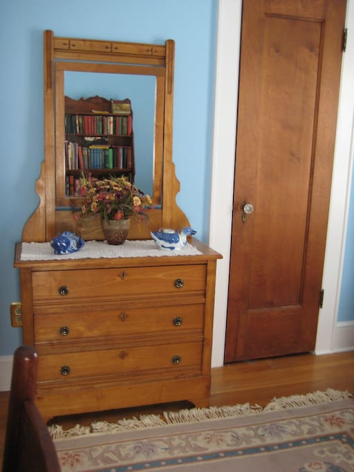 Staying more than 2 nights? Unpack into this vintage bureau and use your nice deep closet! Walk tip toe on your oriental rug.
