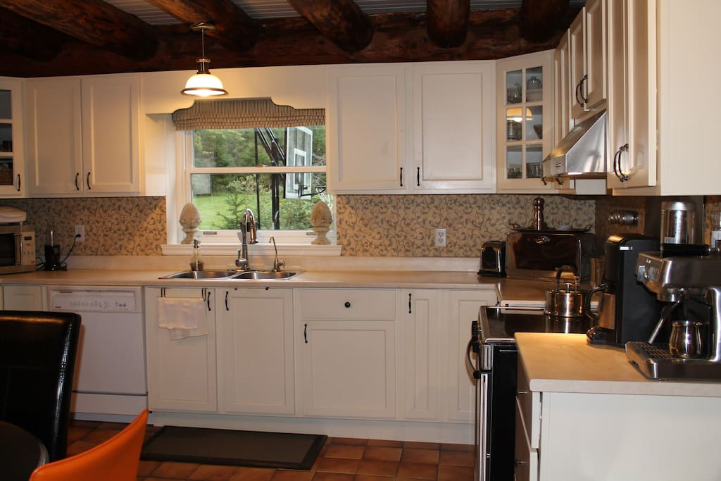 Fully functional kitchen with microwave, coffee maker and dishwasher.