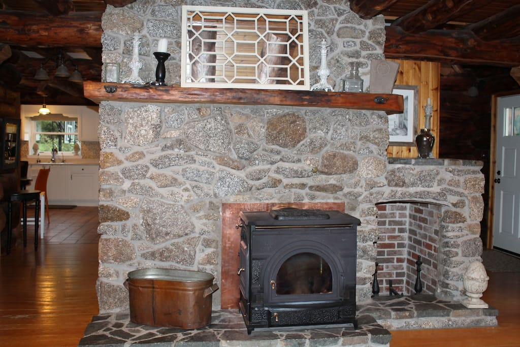 Cozy cast iron fireplace  in the living area.