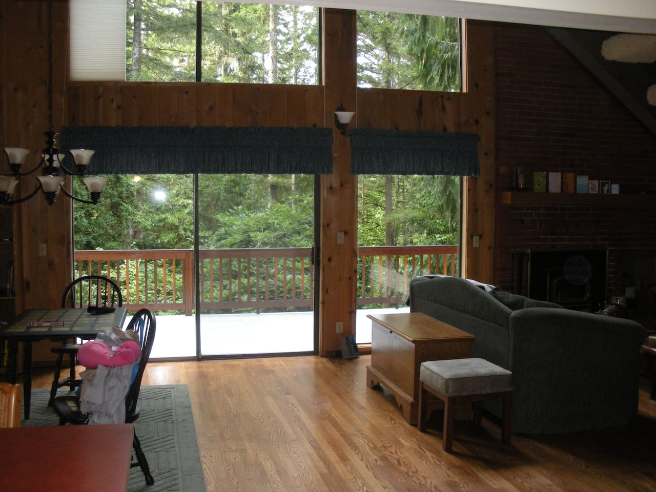 Full wall of windows to enjoy the view of the woods.