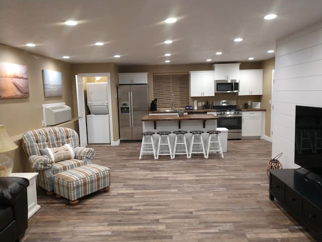 The kitchen island has 5 bar stools.  The outdoor table has seating for 6. And upstairs in one of the bedrooms is a large glass table with seating for 4.  Plenty of places to enjoy a meal.