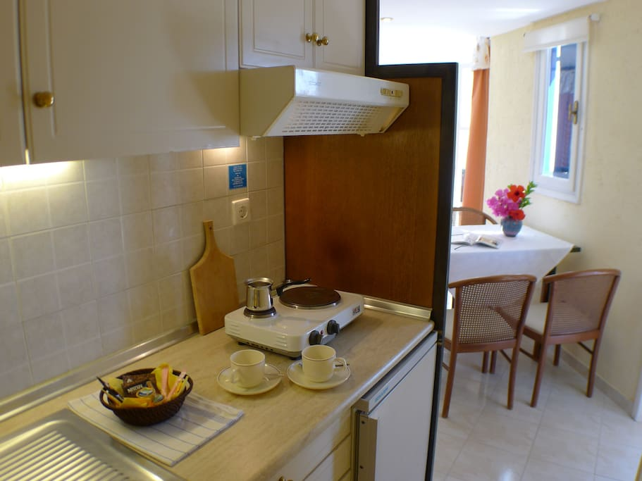 Fully equipped kitchenette with private dining area inside and outside.