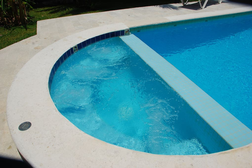The Jacuzzi cascades into the deep end of the pool.