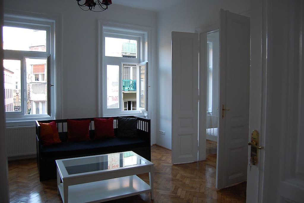 living room , the original wooden parquet and huge doors