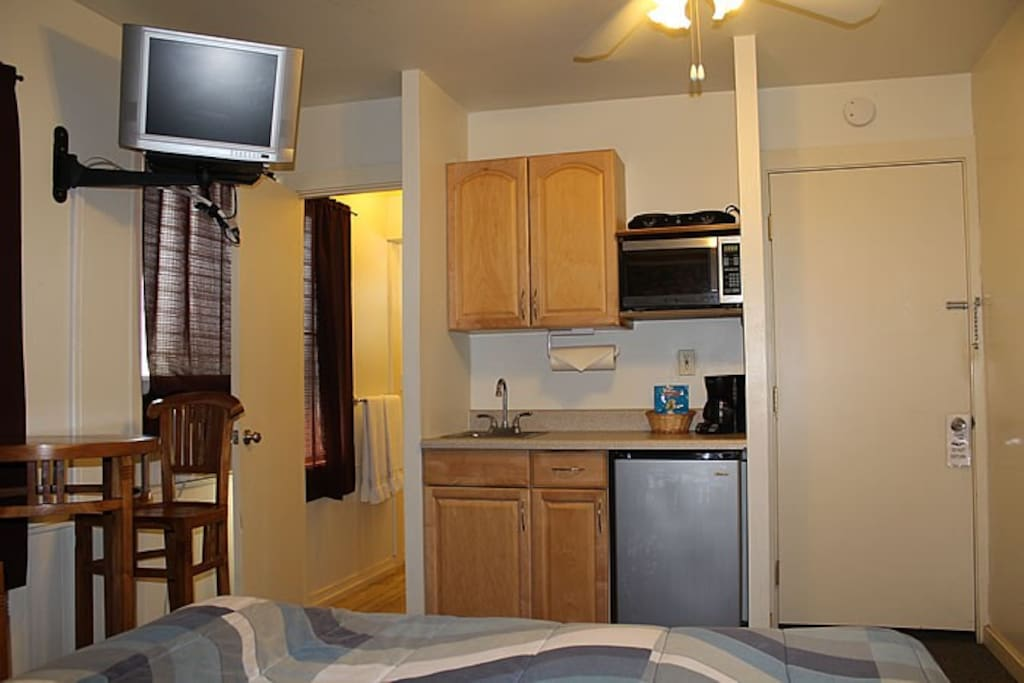Kitchenette offers a coffee maker, microwave, mini fridge and sink.