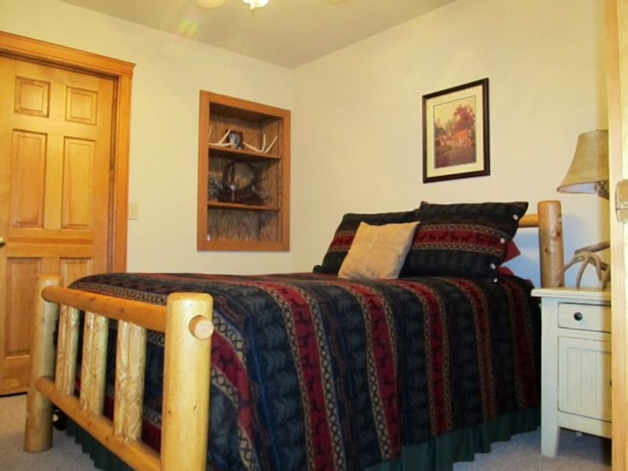First floor bedroom with double log bed
