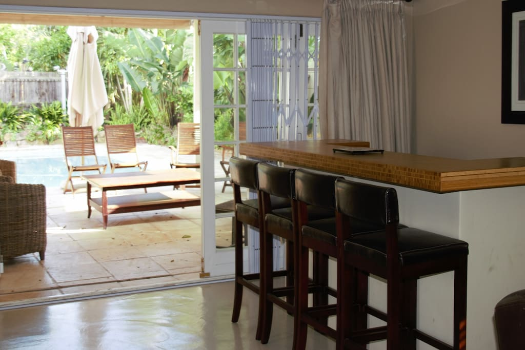 Main Lounge leading past bamboo Bar Area to Braai and pool area